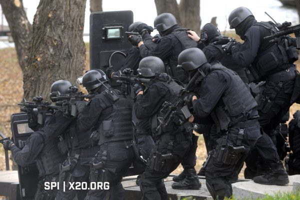 police FBI shields rifeles scopes protective gear ppe